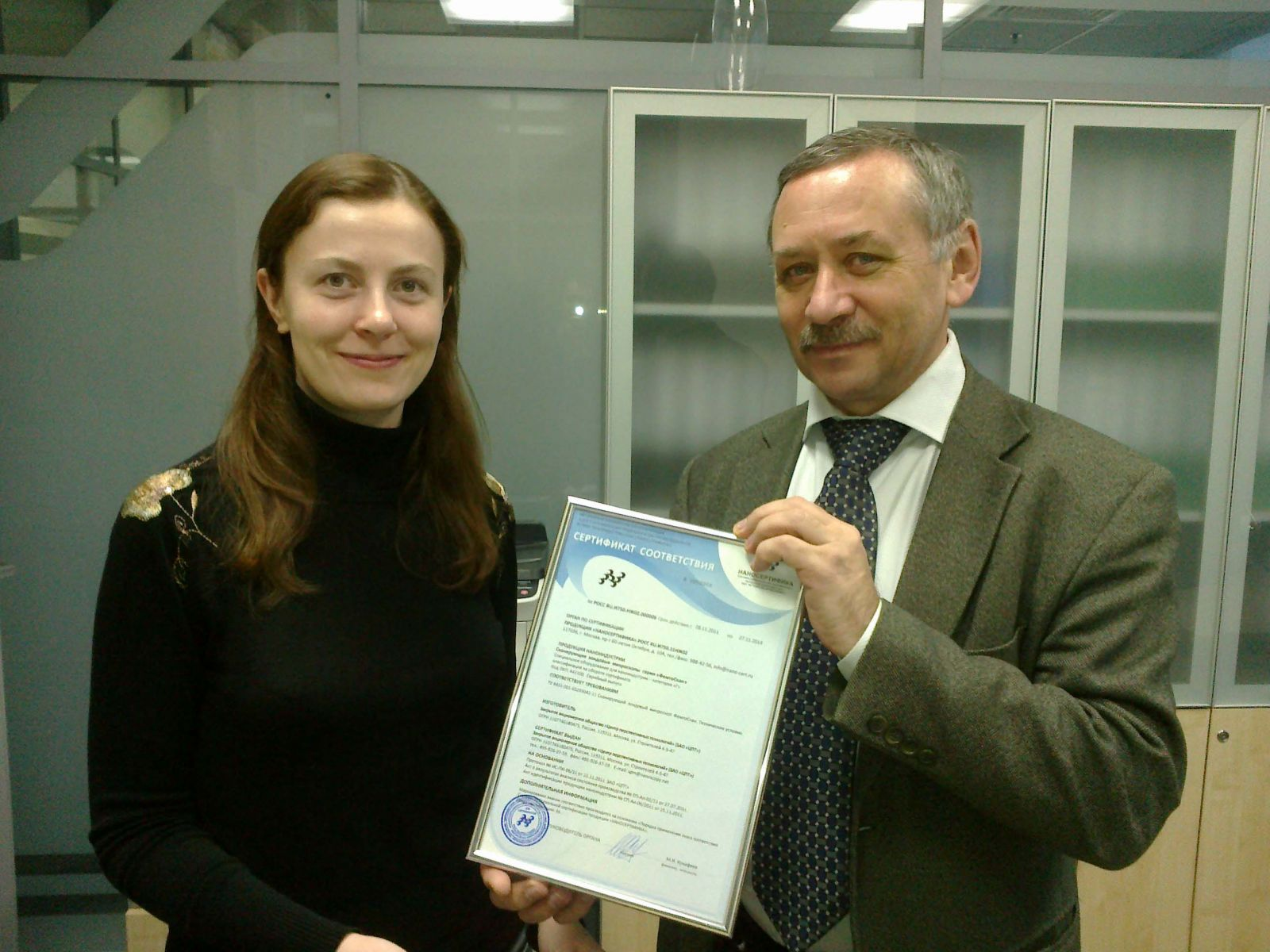 Yuri Toropov, CEO of Nanocertifica, awards Certificate of conformity for SPM FemtoScan to Olga Sinitsyna, responsible for the certification scientific researcher of Advanced Technologies Center
